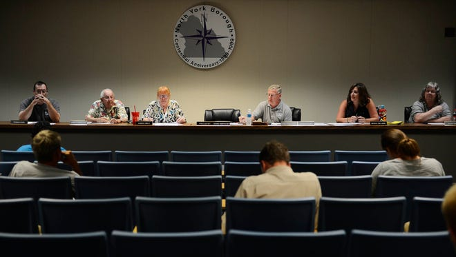 From left Thomas Kuhn, Park Cunningham, Sandra Hinkle, Richard Shank, Natalie Williams, and Joyce Teare during a North York Borough council meeting at the municipal building in North York Tuesday, July 8, 2014.