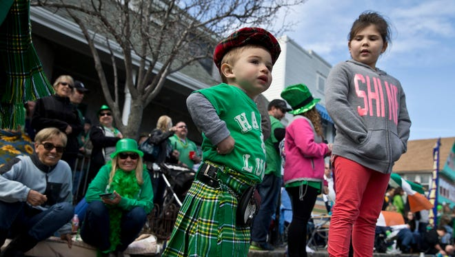 Robinson Cardone, 17 months of Toms River enjoys the parade with his family. The Ocean County St. Patrick's Day Parade makes its way down the Boulevard lined with huge crowds. Seaside Heights, NJ Saturday, March 12, 2016@DhoodHood