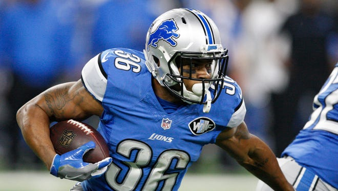 Dec 11, 2016; Detroit, MI, USA; Lions running back Dwayne Washington carries the ball during the first quarter against the Chicago Bears at Ford Field.