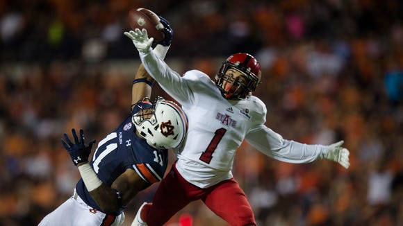 Auburn wide receiver Kyle Davis (11) makes a one-handed catch over Arkansas State defensive back Blaise Taylor (1) during the first half of the NCAA football game Saturday, Sept. 10, 2016, at Jordan Hare Stadium in Auburn, Ala.
