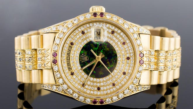 This custom Rolex 18-karat Presidential Men's diamond watch sold for $22,000 during J. Levine's New Year's Day auction last year. The diamond and ruby Rolex featured a fire opal face, diamond encrusted band and bezel. A true show stopper, this vintage watch dates back to the mid-1980s.
