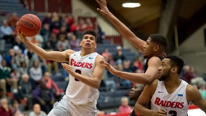 Shippensburg's Justin McCarthur (3) drives around East Stroudsburg's Chris Bing (32) during a men's basketball game on Wednesday, 18, 2017 played at Heiges Field House in Shippensburg, Pa. The Raiders defeated the Warriors 86-82.