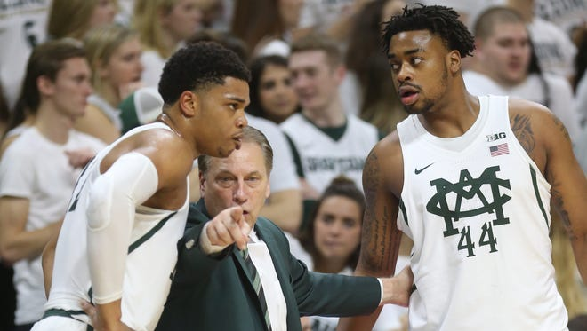 Michigan State head coach Tom Izzo talks to Miles Bridges, left, and Nick Ward in the first half against Michigan on Sunday, Jan. 29, 2017 at the Breslin Center in East Lansing.