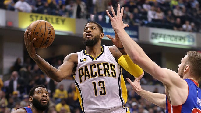 Indiana Pacers forward Paul George (13) shoots a layup during first half action at Bankers Life Fieldhouse, Indianapolis, Saturday, Feb. 4, 2017.