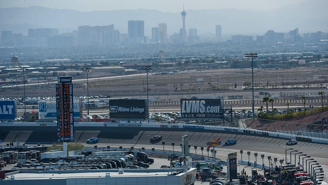With the Las Vegas skyline in the background, NASCAR Cup drivers hit the track for the 2016 Kobalt 400 at Las Vegas Motor Speedway.