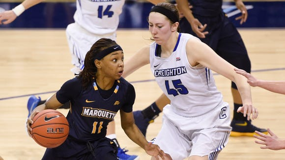 Marquette guard Allazia Blockton drives for the basket against Creighton Bluejays forward Audrey Faber in the third quarter of a Big East Conference women's semifinal at the Al McGuire Center.