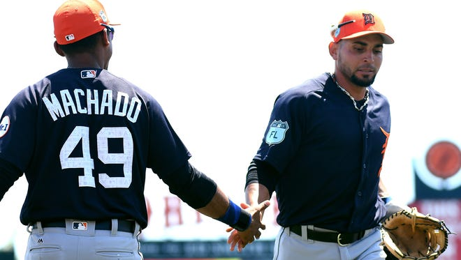 Mar 30, 2017; Sarasota, FL, USA; Tigers infielder Dixon Machado greets Omar Infante after he turned a double play in the second inning of the spring training game against the Baltimore Orioles at Ed Smith Stadium.