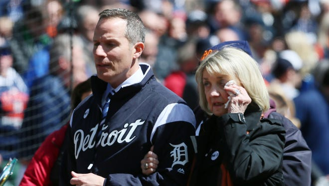 Chris and Marian Ilitch make an emotional exit after a ceremony in remeberance of Mike Ilitch before the Tigers face the Red Sox on April 7, 2017 at Comerica Park.