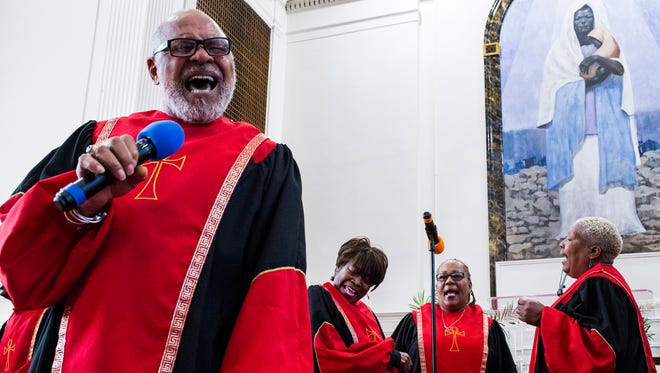 Ireji Flowers, of Detroit, leads the congregation in song during the morning service at the Shrine of the Black Madonna Pan-African Orthodox Christian Church in Detroit on Sunday, April 23, 2017. The church will soon be celebrating the 50th anniversary since the reveal of the Black Madonna painting in it's sanctuary.