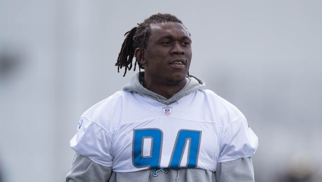 Lions defensive end Ziggy Ansah watches drills during organized team activities June 6, 2017 at the practice facility in Allen Park.