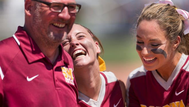 Head Coach Cory Gray (left), laughs with players Sara Beers (middle), and Cassie Smith after Scecina Memorial High School beat Elwood High School 6-2 for the 2A state softball title, from Ben Davis High School, Indianapolis, Saturday, June 10, 2017.