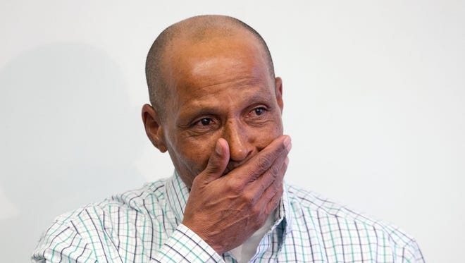 Louis Taylor, 59, gets emotional during a news conference Wednesday, April 3, 2013, the day after he left prison, having served more than 40 years. The man who spent most of his life behind bars is weighing his next steps.