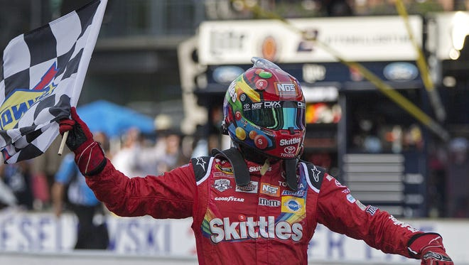 Kyle Busch celebrates his victory at the end of the 23rd annual Brickyard 400 at Indianapolis Motor Speedway, Sunday, July 24, 2016.