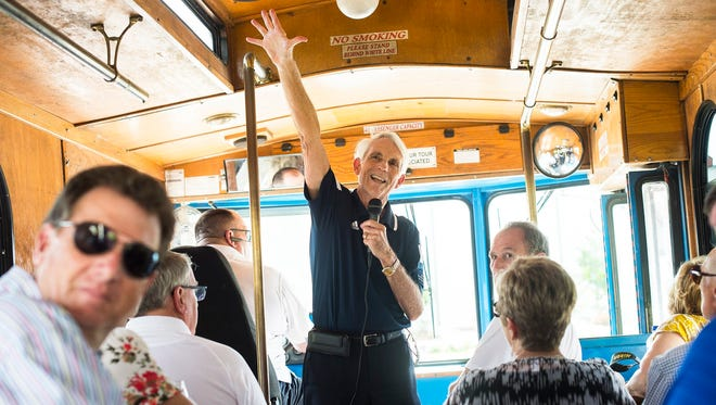 Jack Wert, executive director of the Convention & Visitors Bureau, talks with passengers on Thursday, July 27, 2017, during a reception and trolley tour to view the land where the new Sports Complex will be built in Naples, Fla. This complex was approved last month by a unanimous vote by the TDC and Collier commissioners. It will be an amateur Sports Complex.