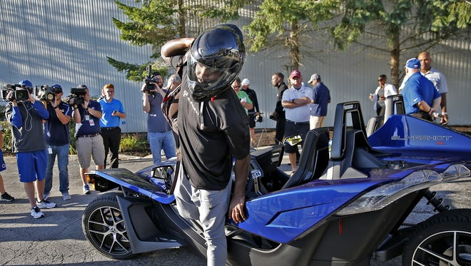 Vontae Davis gets out of a Slingshot roadster after being photographed in the roadster at the Indianapolis Colts complex before the start of Colts Camp, Saturday, July 29, 2017.  Davis had been driven in the vehicle to the complex.