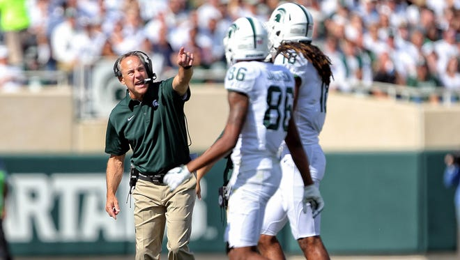 Sep 9, 2017; East Lansing, MI, USA; Michigan State head coach Mark Dantonio gestures to Spartans receiver Trishton Jackson (86) and Felton Davis III (18) in the first quarter of a game at Spartan Stadium.