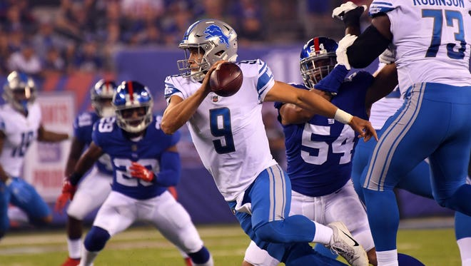 Lions quarterback Matthew Stafford runs with the ball against the Giants at MetLife Stadium on Monday, Sept. 18, 2017
