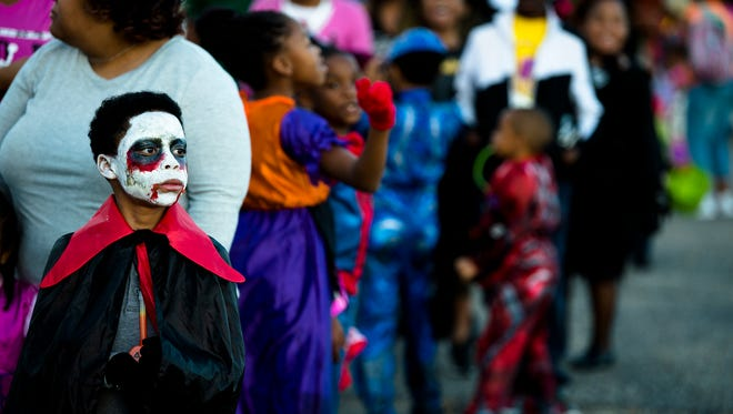 Cameron Spencer, 8, dressed as Dracula, waits in line during the Montgomery County Sheriff's Office Annual Halloween Spooktacular on Tuesday, Oct. 31, 2017, in Montgomery, Ala.
