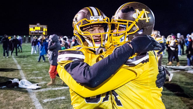 Monroe Central celebrates defeating Southwood in their regional game at Monroe Central High School Friday, Nov. 10, 2017.