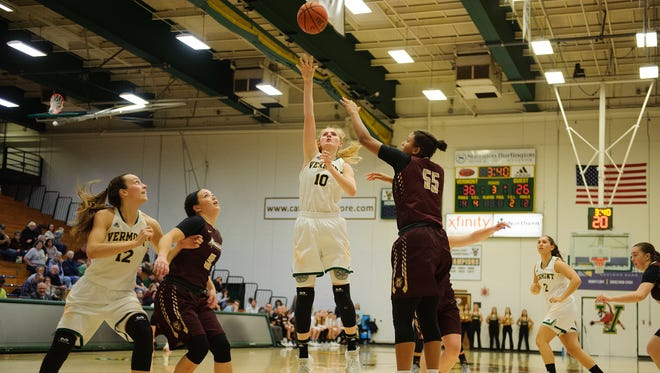 Catamount forward Hanna Crymble (10) leaps to take a shot during the women's basketball game between the Norwich Cadets and the Vermont Catamounts at Patrick Gym on Wednesday night November 15, 2017 in Burlington.