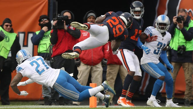 Glover Quin misses the tackle on the Chicago Bears' Tarik Cohen,  who dives for a touchdown in the fourth quarter of the Detroit Lions' 27-24 win Sunday, Nov. 19, 2017 at Soldier Field in Chicago.