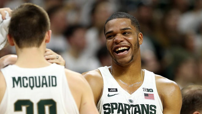 Miles Bridges laughs with Matt McQuaid during the first half of Michigan State's 86-57 win over Nebraska on Dec. 3, 2017 at Breslin Center.