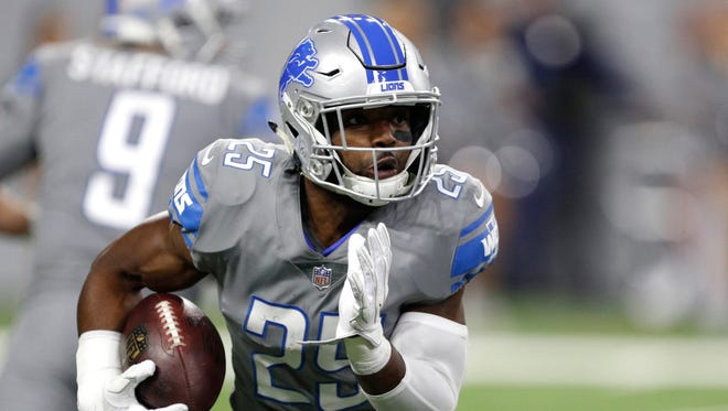 Dec 16, 2017; Detroit, MI, USA; Detroit Lions running back Theo Riddick runs the ball during the first quarter against the Chicago Bears at Ford Field.