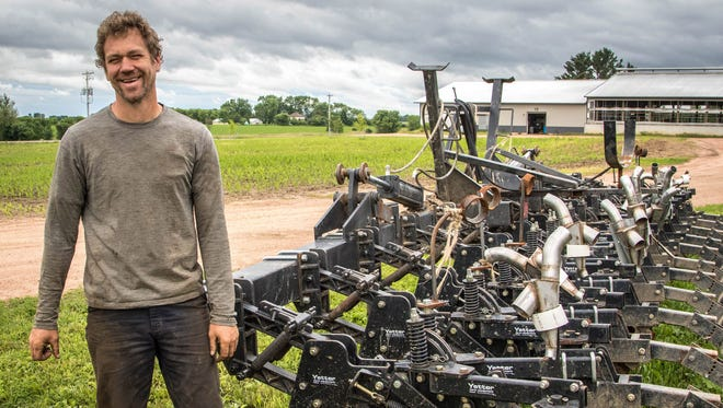 Shannon Nickolay custom built his own strip-till machine to use on the cool, we soils of Marathon County.