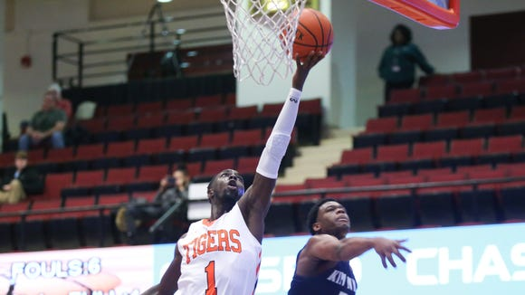 Spring Valley's Xavier Gibbs (1) puts up a shot over