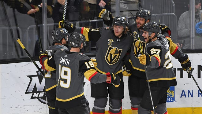 Vegas Golden Knights players celebrate a third-period goal scored by center William Karlsson (71) against the New York Rangers at T-Mobile Arena.