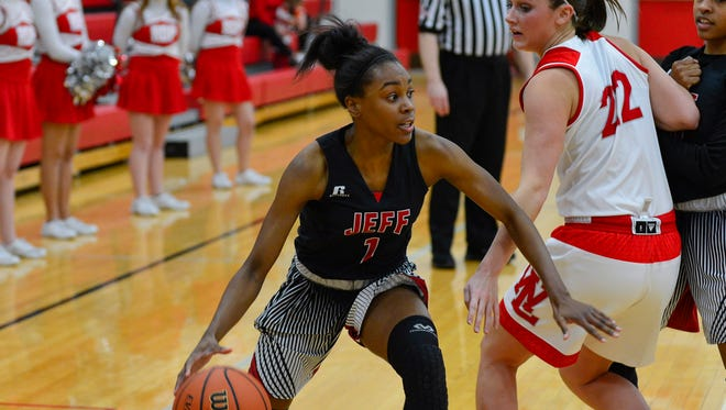 Nykela Haskins drives to the basket in the Lafayette Jeff Broncos at West Lafayette Red Devils girls basketball game on January 16, 2018