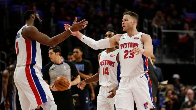 Detroit Pistons forward Blake Griffin (23) high fives center Andre Drummond in the first half against the Memphis Grizzlies at Little Caesars Arena on Thursday, Feb. 1, 2018.