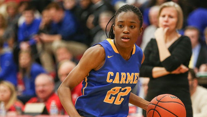 Carmel Greyhounds Tomi Taiwo (22) works a possession during semifinals action between the Carmel Greyhounds and Noblesville Millers at Fishers High School in Fishers, Ind., Friday, Feb. 2, 2018. Carmel won, 50-45.