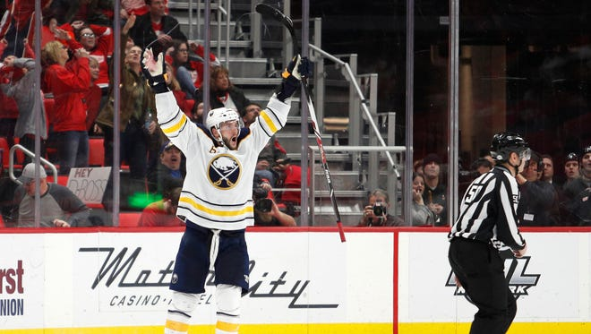 Sabres' Marco Scandella celebrates after scoring the winning goal in overtime against the Red Wings on Thursday.