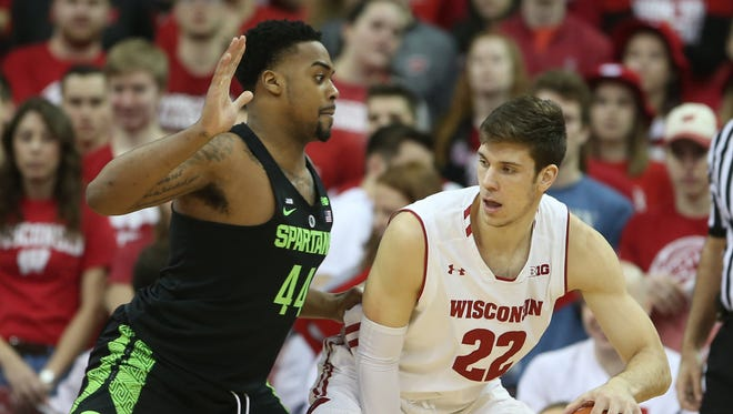 Feb 25, 2018; Madison, WI, USA; Wisconsin forward Ethan Happ dribbles against Michigan State forward Nick Ward during the first half at the Kohl Center.