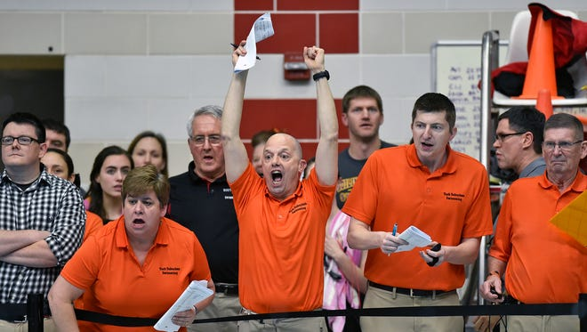 York Suburban coaches cheer during the anchor lap of the girls' 200-yard medley relay in the PIAA District 3 AA girls' swimming championships Friday, March 2, 2018, at Cumberland Valley. The Trojans' relay team placed third in the event.