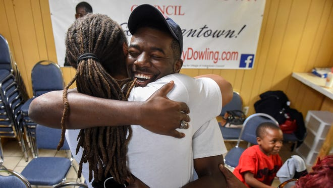 """""""It's long overdue and now Indiantown definitely has a voice,"""" said newly elected Village of Indiantown Councilman Anthony Dowling before getting a hug from his first cousin, Leonard Parks, Tuesday, Mar. 13, 2018, after Indiantown residents voted to elect five of the 10 candidates, including Dowling, to serve as Indiantown's first village council. Dowling celebrated his victory with supporters, family, and friends at his campaign office in 16205 Southwest Warfield Blvd. in Indiantown."""