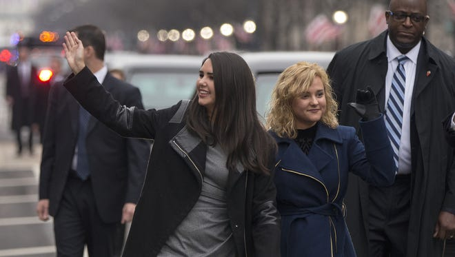 (From left) Audrey and Charlotte Pence, daughters of Vice President Mike Pence, walk in the Inaugural Parade on Pennsylvania Avenue in Washington, D.C., on Jan. 20, 2017.