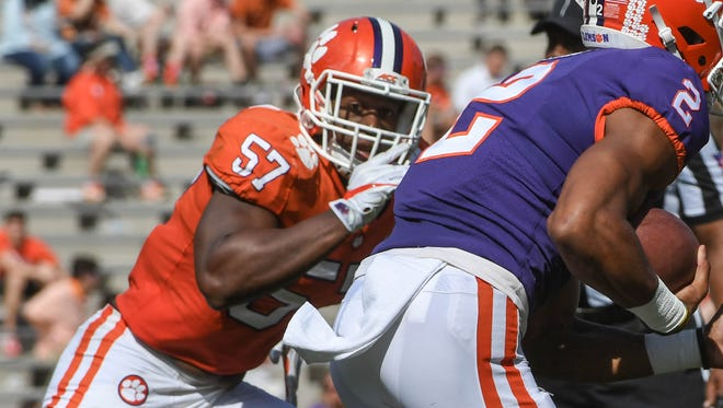 Clemson linebacker Tre Lamar (57) pursues Kelly Bryant during the the spring game in Memorial Stadium in Clemson on Saturday, April 14, 2018.