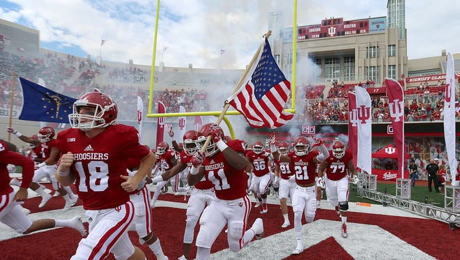 The Indiana Hoosier take the field to face the Ball State Cardinals at Indiana University's Memorial Stadium, Bloomington, Ind., Saturday, September 10, 2016.