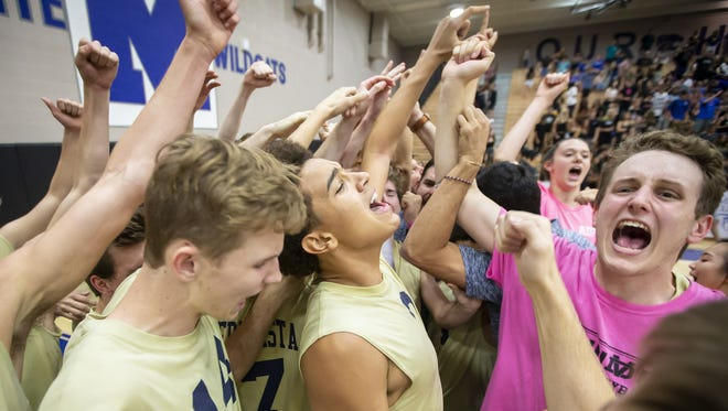 The Desert Vista Thunder celebrates their 3-0 win against the O'Connor Eagles in the 6A Boys Volleyball State Championships at Mesquite High School on Friday, May 11, 2018 in Gilbert, Arizona.