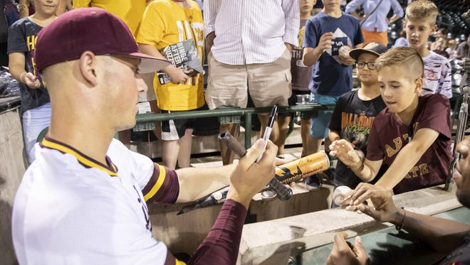 Freshman Spencer Torkelson (20) signs autographs for fans following Arizona State's season finale at Phoenix Municipal Stadium on Saturday, May 26, 2018.