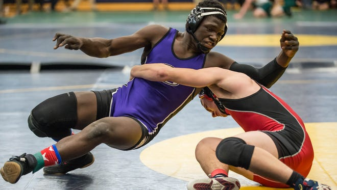 Lakeview's Stephan Moody wrestles Marshall's Justin Saari at 152 pounds in the Bill Evans Memorial Invitational at Battle Creek Central on Saturday.