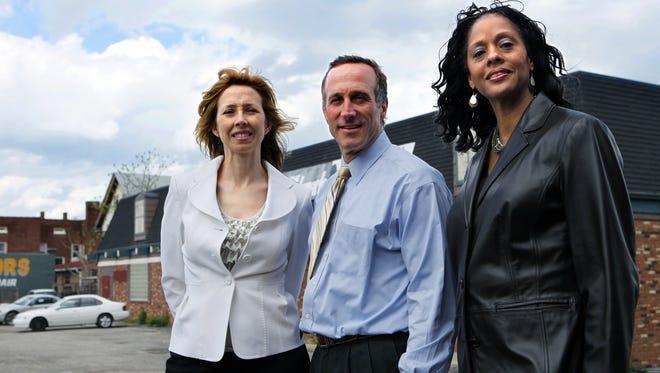 Dan Schimberg, center, president of Uptown Rental Properties