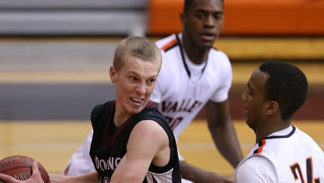 Dowling Catholic's Ben Olson, left, grabs a rebound from Valley's Dominique Dafney last season. Olson averaged 8.8 points per game as a junior in 2014-15.