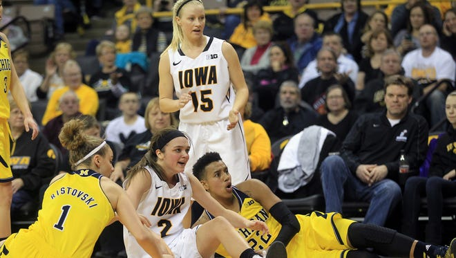 Iowa's Ally Disterhoft (2) and Whitney Jennings (15), seen here during a January game against Michigan, are the Hawkeyes' two returning starters.