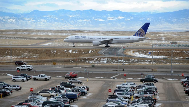 A United Airlines airplane taxis before takeoff at Denver International Airport.