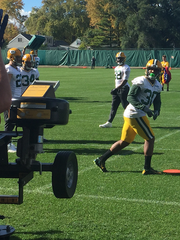 Newly acquired RB Knile Davis catches passes from a jugs machine at practice.