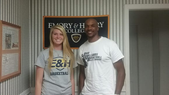 Avery County senior Jessica Hoilman has signed to play college basketball for Emory & Henry (Va.). She is pictured here with local coach John Williams.
