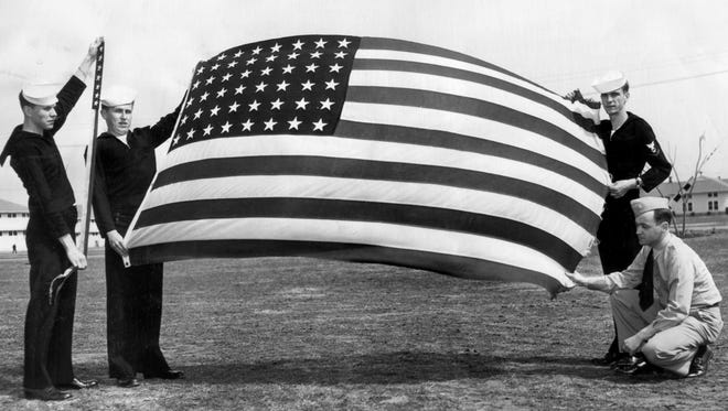 March 10, 1947 - The wind-tattered flag that flew from the U.S.S. Memphis will become the permanent property of the Memphis Museum, as will her commission pennant that fluttered from her forepeak. Presentation will be made on March 30 at the Museum by the navy with the Navy League cooperating. R.N. Paurch, Storekeeper 3-c (left), holds the pennant; with the flag (from left) are Roy Bong, Yeoman, 3-c; Harold Allen, Yeoman 3-c and Chief Petty Officer Jack Nugent on March 10, 1947.